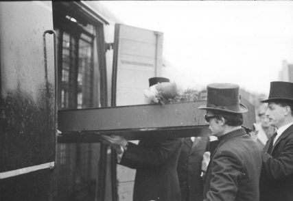 Coffin is Piped Aboard