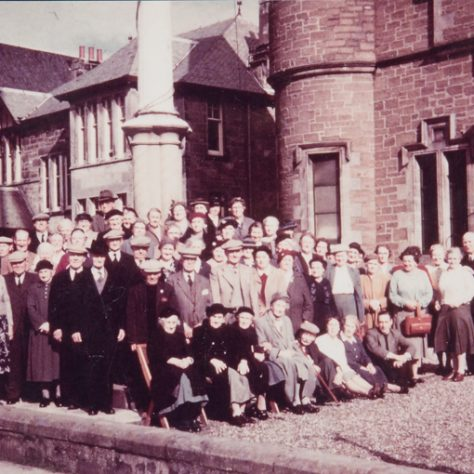Members of the Old Folks' Club Beside flagpole outside Blyth Hall 1956.